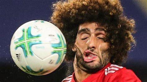 man uniteds marouane fellaine  hit   face