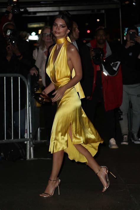 Emily Ratajkowski dazzles in a yellow silk dress as she ...