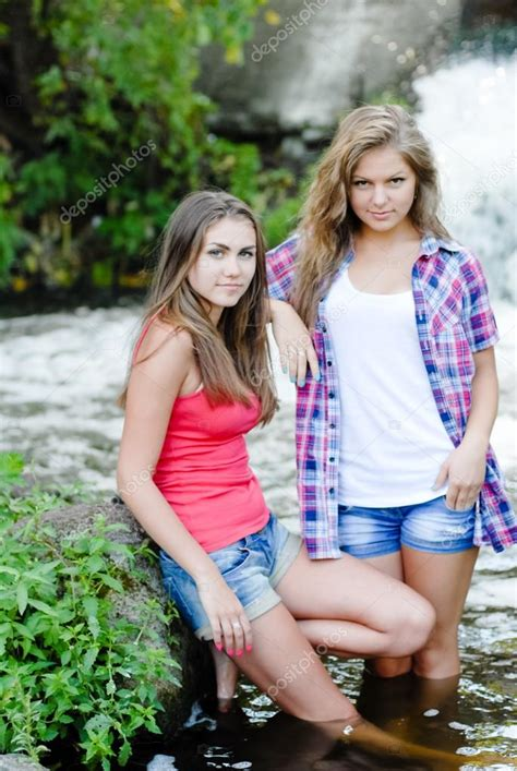 Two Teen Girls And Summer Outdoors Near Waterfall — Stock