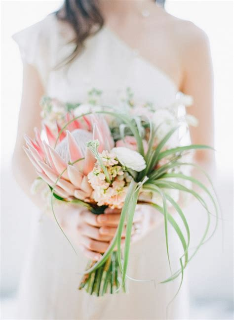 King Protea Bouquet With Wispy Air Plants Brides