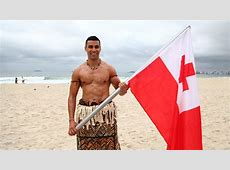 Pita Taufatofua, the flag bearer from Tonga, shines on
