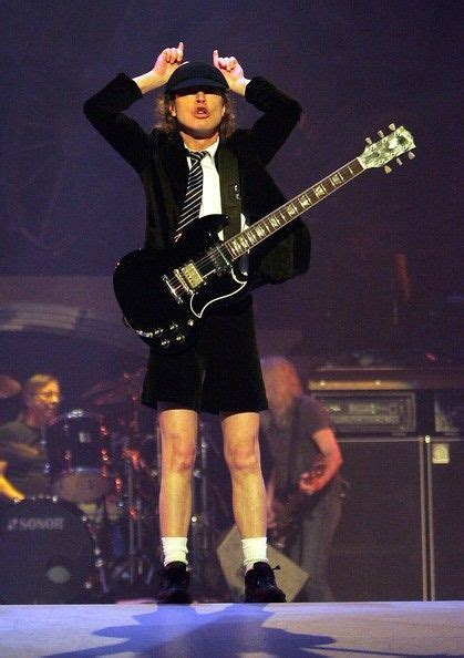 angus young   acdc performing  concert