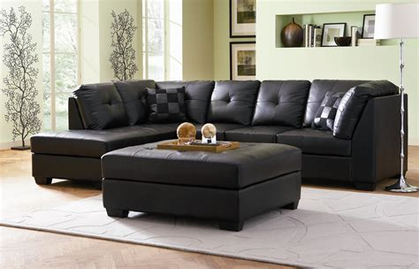 Black Leather Small Sectional With Chaise Lounge On Brown