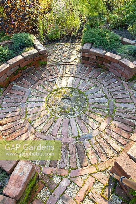Gap Gardens  Circular Brick Patio In Herb Garden  Image. Brick Patio Coating. Patio Swing Plans. Patio.com Outlet. Mortaring Flagstone Patio How To. Install Patio Blocks. Paver Patio Kitchen. Patio Restaurants Boston. Patio Setup Ideas