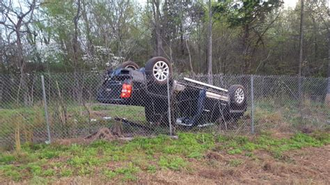 pickup truck flips  st airborne division pkwy