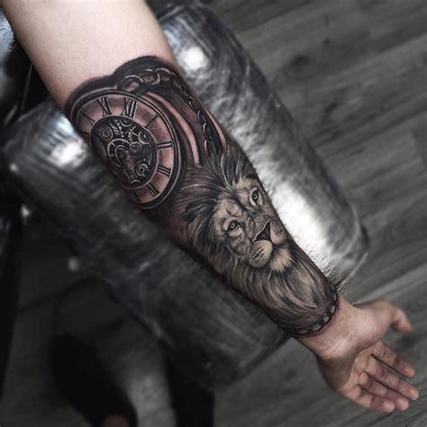 arm tattoo lion tattoo clock tattoo tatuaggio
