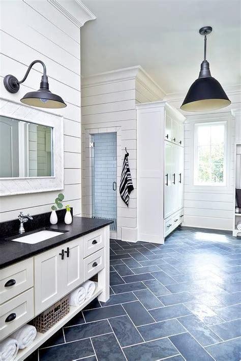 black  white cottage mudroom  clad  dark slate herringbone floor tiles lit   black