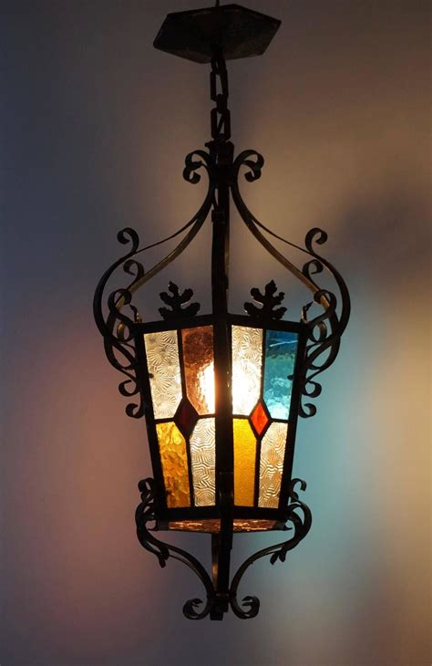 wrought iron lantern chandelier with stained glass for