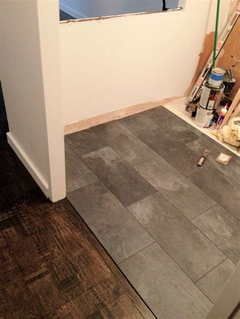 kitchen tile laminate flooring the kitchen floor looks like slate but its really a pergo 6273