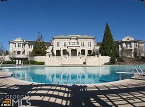 Rick Ross S House by Rick Ross Spends 5 8 Million For Evander Holyfield S 109