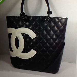 CHANEL - WANT! Black Chanel purse with white CC logo from ...