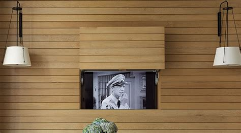 window bench with tv design idea hide your tv within a wall contemporist