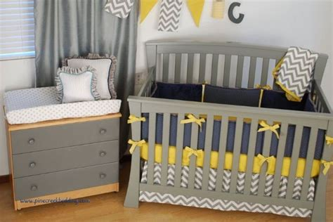 A Blue And Gold Nursery With Grey Chevron