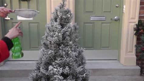 flocking add fake snow   artificial christmas tree