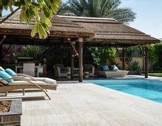 Thatched Roof House With Outdoor Entertaining Spaces by Modern Thatched Gazebo With Pergola Extension Seating