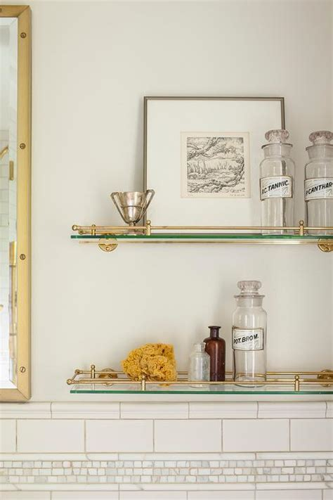 Glass and Brass Vintage Glass Shelves Above Toilet