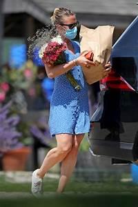 johansson in a blue mini dress picks up flowers