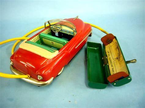 Tin Toy / 50's Pontiac Masudaya-made Electric Remote