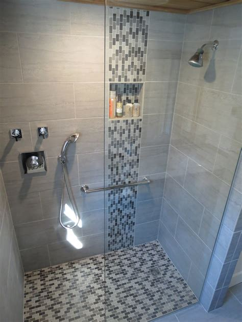 gray glass tile shower room with glass mosaic accent with
