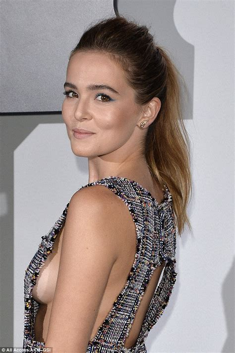 Zoey Deutch flashes some serious sideboob as she attends ...