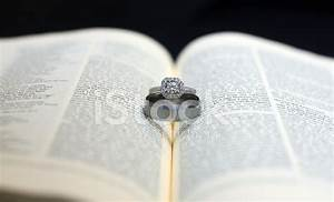 Wedding rings on holy bible stock photos freeimagescom for Wedding ring meaning bible