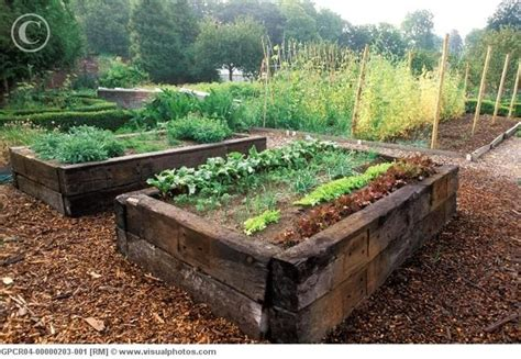 railroad ties for garden re using old railway sleepers to build planters gives the instand country garden look