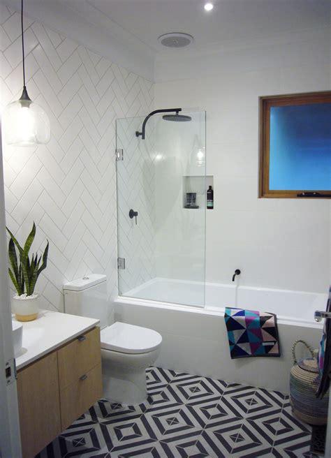 stunning bathroom featuring phoenix tapware matte black