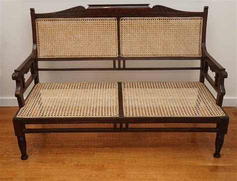 wooden settee antique wood and caned settee at 1stdibs