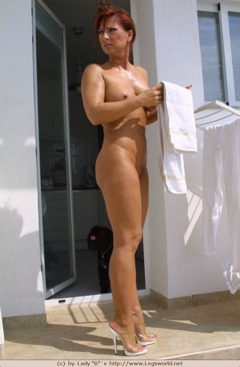 Leggy and curvy mature lady without panties on these.. - big photo #1