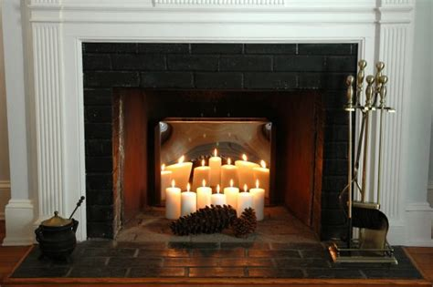 candles inside fireplace creative ways to decorate your fireplace