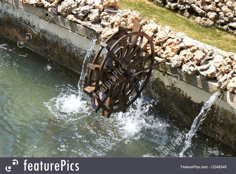 power  energy water wheel  fountains stock