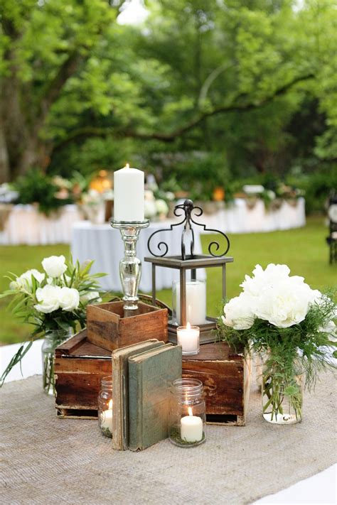 vintage books   lantern   candles #centerpiece   Wedding Reception Centerpieces   Pinterest