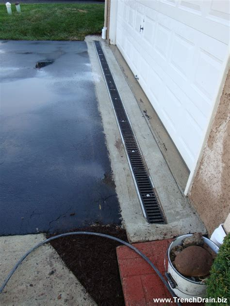 concrete driveway drainage driveway drain installation installed driveway drain new place space pinterest driveways