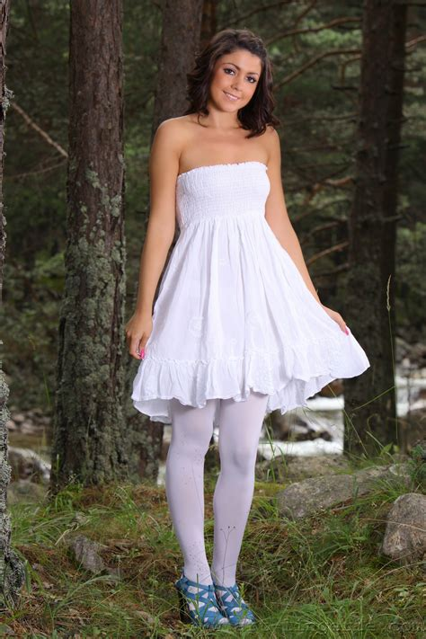 Cute White Dress And Sexy White Stockings On Teen Posing