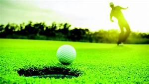 A photo of a golf ball on the green.
