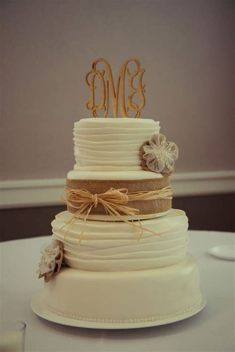 Rustic Wedding Cake With Burlap And Straw Ribbon And