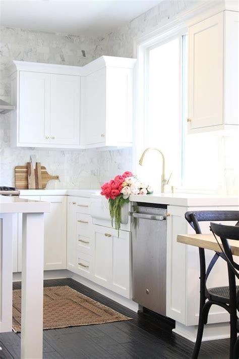 white kitchen  white glazed subway backsplash tiles