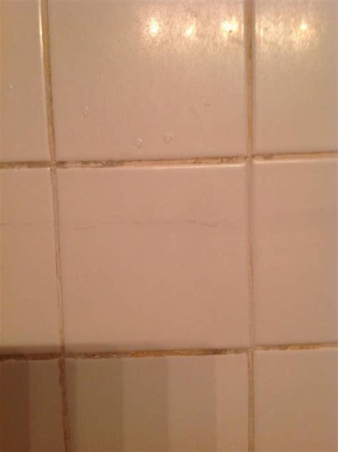 repair cracked bathroom tile runs  entire length