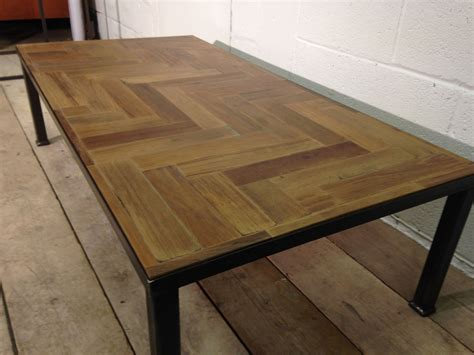 This reclaimed wood table is handcrafted and has a lower ledge that you can use to add picture frames and decors. Reclaimed Parquet Coffee Table