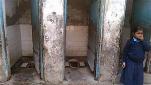 lack of toilets compels slum women to relieve in unsafe zone With indian public bathroom