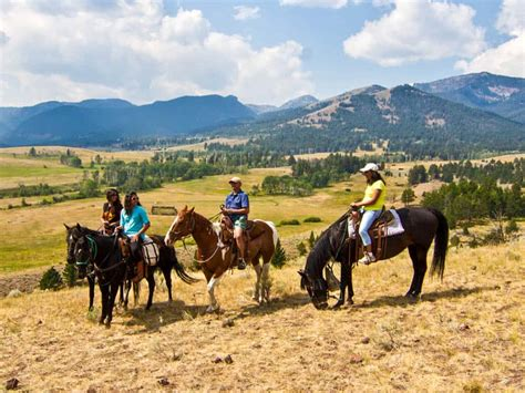 horseback yellowstone riding riders near
