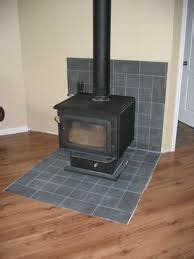 remodeling  wood stove wall shield  river rock faux