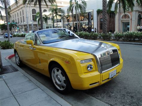 yellow rolls royce rolls royce phantom drophead coupe zero to 60 times