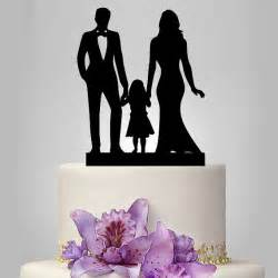 family wedding cake topper and groom with