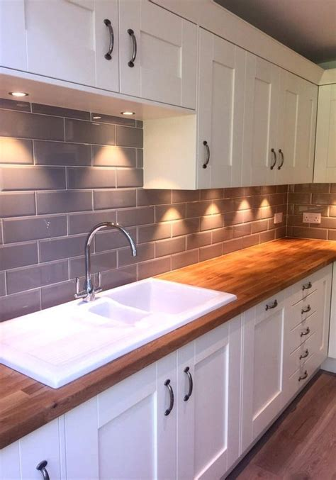image result  cream cabinets brick tiles wood worktop