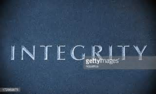integrity carved on a blue marble stock photo