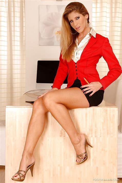 Stunning Milf Jennifer Stone Showcasing Her Sexy Legs In