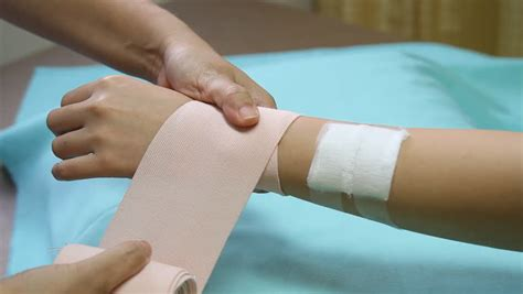 Stock Video Clip Of First Aid ,applying Bandage For Wrist