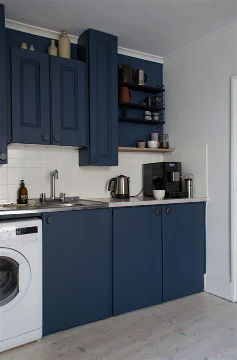 kitchen cabinet displays for our nordic blue kitchen before and after reveal curate 7774