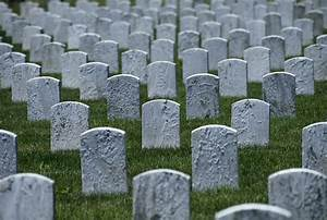 A View Of Lines Of Unmarked Gravestones Photograph by